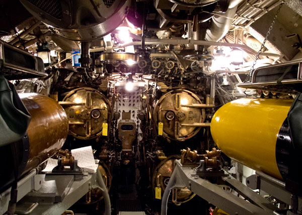 The forward torpedo room has four tubes, filled with torpedoes, with